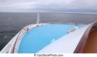 Huge liner floats by sea against cloudy sky in afternoon