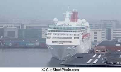 Huge liner stands in dock of Copenhagen. - Huge liner stands...