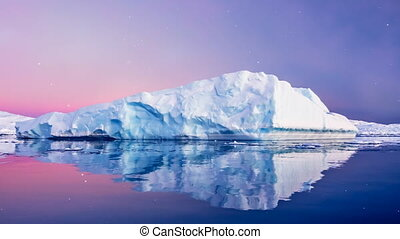 Huge long iceberg with mirror reflection in water -...