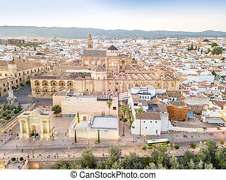 Huge mosque - cathedral and Saint Rafael Triumph Arch in the heart of Cordoba, Andalusia, Spain