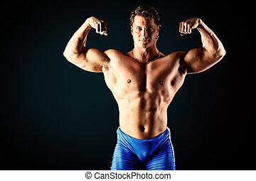 huge muscles - Portrait of a handsome muscular bodybuilder...