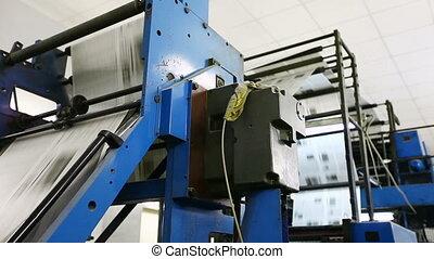 huge newspaper machine in a print shop