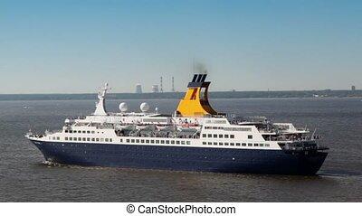 Huge passengers liner float away from port near coastline