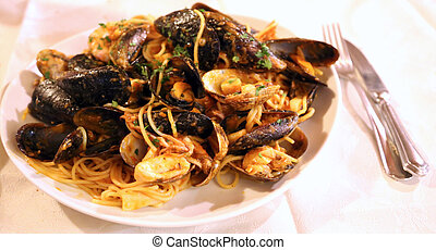 spaghetti with mussels and prawns in seafood restaurant