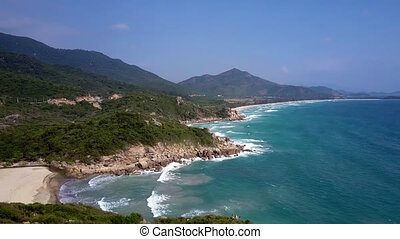 tremendous upper view huge powerful azure ocean washes rocky hilly seashore against boundless blue sky