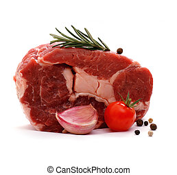 Huge raw ribeye steak garnished with spices, isolated