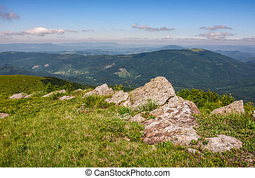 huge rocks on the edge of hillside. fine weather in summer...