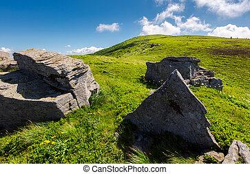 huge rocky formation on hillside. lovely summer scene in...