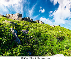 huge rocky formation up the hill. lovely summer scenery in...