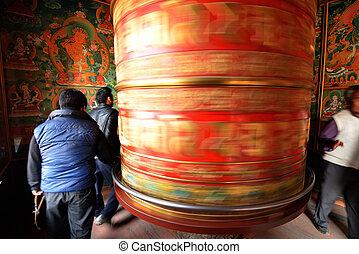Huge rotating praying drum in Boudhanath stupa, Kathmandu, nepal