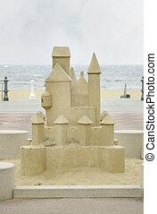 huge sandcastle - a large carved stone sandcastle near the...