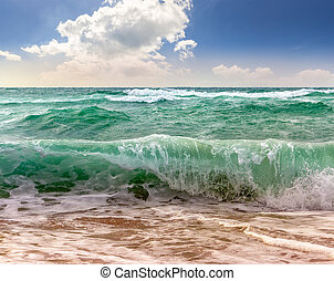 huge sea ??waves running on sandy beach - close up of huge,...