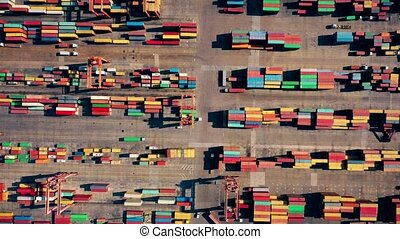 Huge seaport. Trade between countries. Aerial view of containers at sea port. Logistics and delivery.