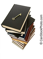 Huge stack of books with a skeleton key on top