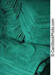 huge stack of green towels