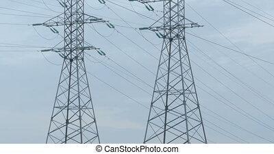 Huge steel poles of high voltage transmission line, panorama...