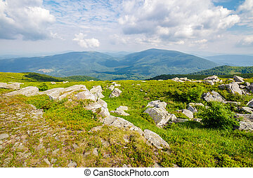 huge stones in valley on top of mountain range - mountain...
