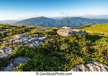 huge stones in valley on top of mountain range - mountain...