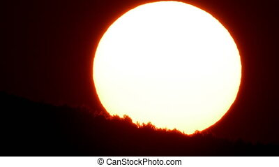 Huge sun behind the mountain at sunrise - Huge sun circle...