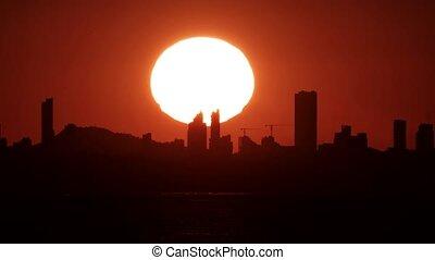Huge sunset over Benidorm city skyline - Long shot of huge ...