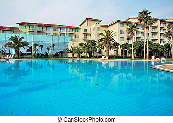 Huge swimming pool with luxurious resorts - Huge swimming...