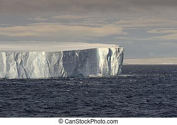 Huge Tabular Iceberg Floating In Bransfield Strait Near The Northern Tip Of The Antarctic Peninsula, Antarctica