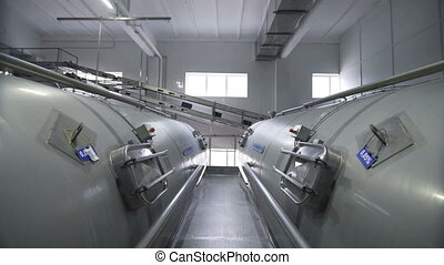 Huge tanks for storing and fermenting milk. Pipeline in...