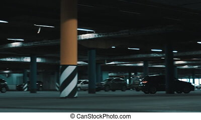 Huge underground parking. - Motion shot of huge underground...