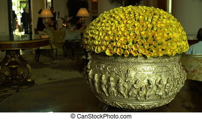 Huge vase filled with yellow roses - A steady, medium shot...