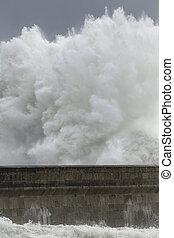 Huge wave splash over pier