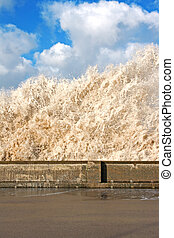 Huge waves crashing onto promenade