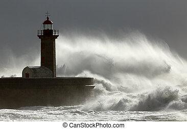 Huge windy wave against lighthouse