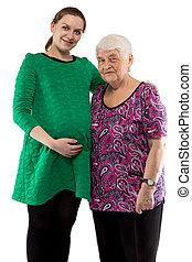 Hugging grandmother and granddaughter