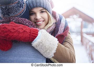 Hugging in winter day