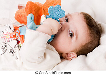 Hugging my toy - Cute asian baby is happy and playfull