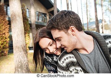 hugging near house