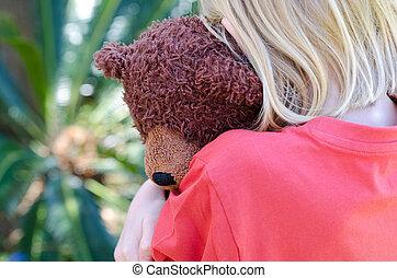 Hugging teddy - Little blond girl hugging her teddy