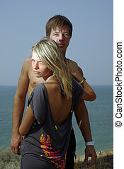 Hugging young couple on a beach