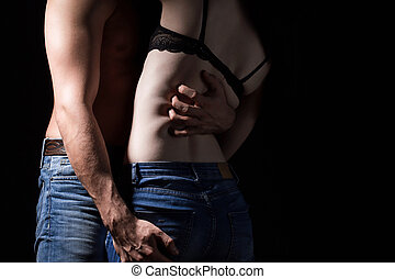 Hugging young lovers in jeans