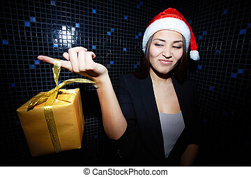 Huh - Portrait of young businesswoman in Santa cap holding ...