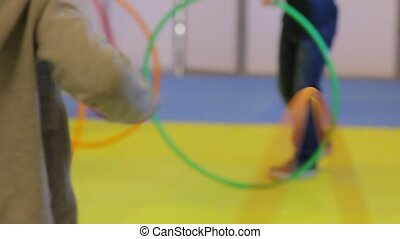 Hula Hoop Exercises - Children do exercises with hula hoop...