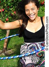 Hula hoop girl - Hula hoop. Beautiful young woman having fun...