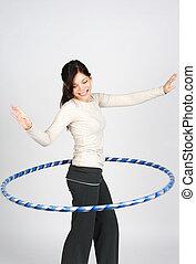 Hula hoop - Happy girl doing hula hoop