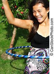 Hula hoop woman - Hula hoop. Very beautiful young woman...