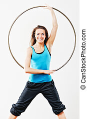 Hula-Hoop - Young women in tracksuit with hula-hoop in...