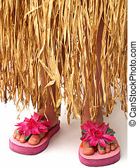 hula skirt and flip flops - bottom half of a girl wearing a...