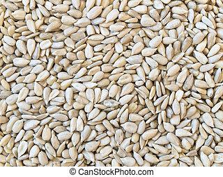 sunflower seeds background - hulled sunflower seeds...