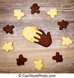 Human and Hand shape cookies, concept together intercultural and multiracial friendship