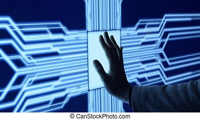 Human arm is pressing a digital button on a glowing touchscreen. Futuristic microprocessor is starting the operation of the computer program. Machine learning and artificial intelligence concept.