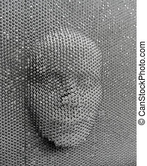 human face made from pin board toy - close up of human face...